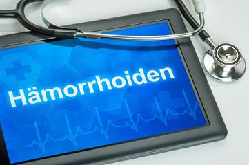 Tablet mit der Diagnose Hämorrhoiden auf dem Display