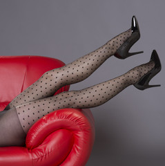 Woman wearing black spotted tights