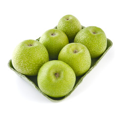 Granny Smith apples in a tray on a white background..