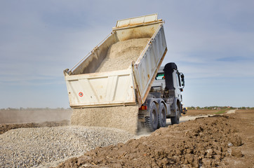 Truck tipping gravel