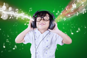 Little girl enjoys the music melody
