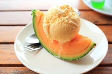 Vanilla Icecream with melon piece summer dessert