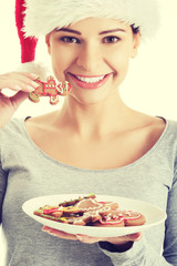 Woman holding a plate with christmas biscuits