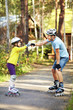 Leinwandbild Motiv Dad and daughter in a helmet