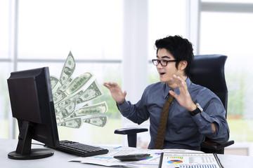 Surpised businessman getting money