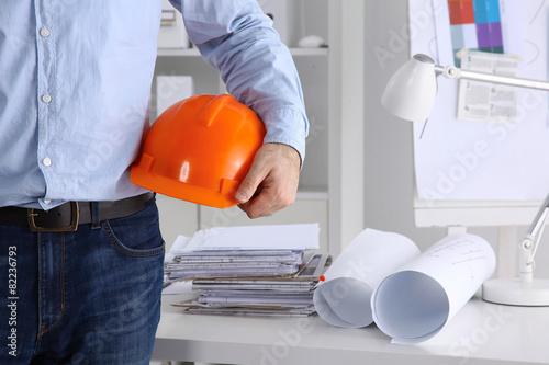 Man architect wearing suit holding helmet - 82236793