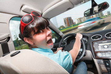 Driving lessons. The woman behind the wheel.