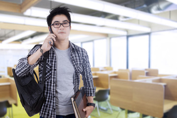 Trendy student speaking on the phone