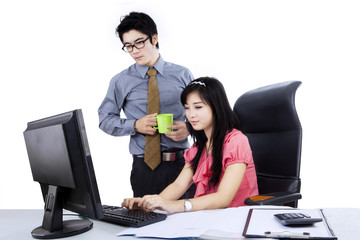 Two business people using computer