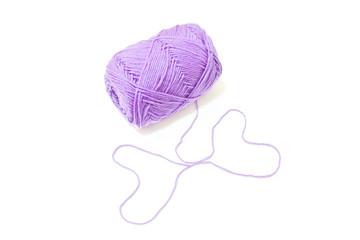 Violet yarn on white background