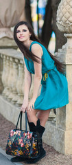 the calm woman with long hair in  blue dress