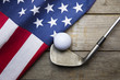 Golf ball with flag of USA on wood table - 82241174