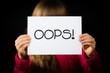 Child holding OOPS sign - 82241580