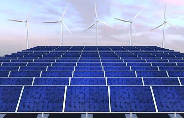 Solar panels and wind generators against sunset sky