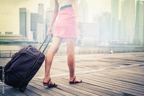 tourist or woman adventure with luggage in Singapore - 82244776