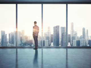 Businessman looking at city. 3d render