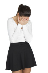 Young woman covers her face with her hands in grief