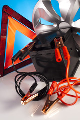 Car battery with two jumper cables clipped on vivid moto concept