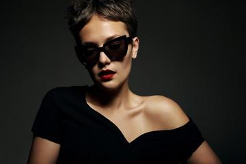 dark portrait of woman wearing sunglasses