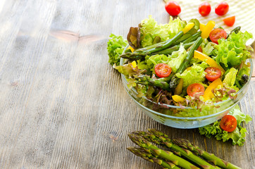 Fresh mix salad with green asparagus for healthy snack
