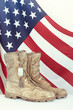 Old combat boots and dog tags with American flag - 82252722