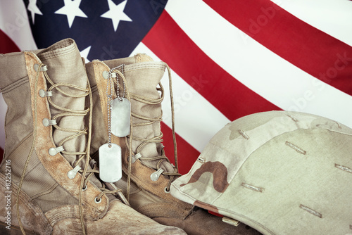 Leinwanddruck Bild Old combat boots, dog tags, and helmet with American flag