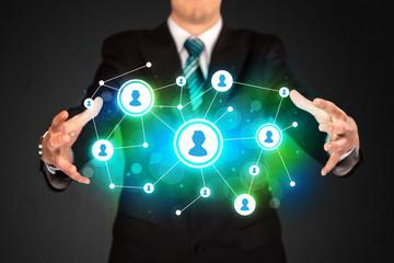 Businessman holding social media network