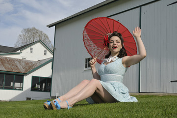 pin up girl with a red perasol