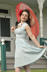 playful pin up girl with a red parasol