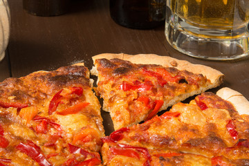 Sicilian style pizza with beer