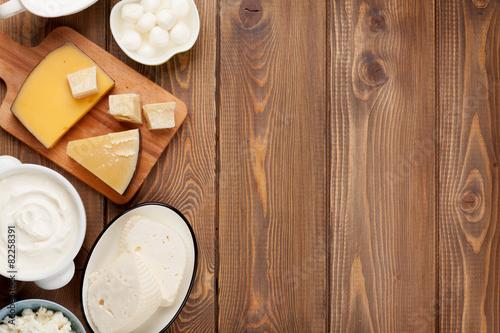 Staande foto Zuivelproducten Sour cream, milk, cheese, eggs, yogurt and butter