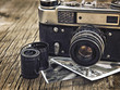 old vintage camera closeup on wooden background - 82258729