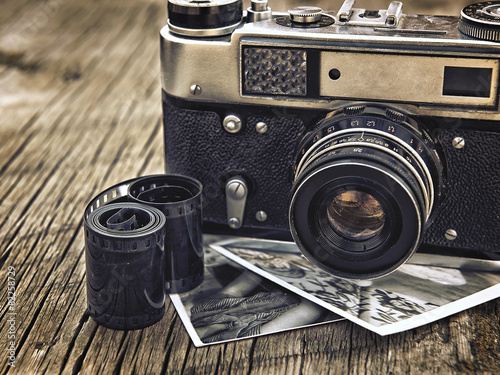 obraz PCV old vintage camera closeup on wooden background