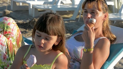 A young girl and her mother enjoy ice cream