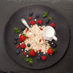 Oatmeal cereal, milk and berries. top view