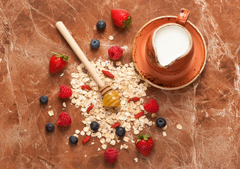 oat flakes, milk, honey and berries. Food background