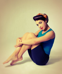 woman sitting in sport clothes in retro style