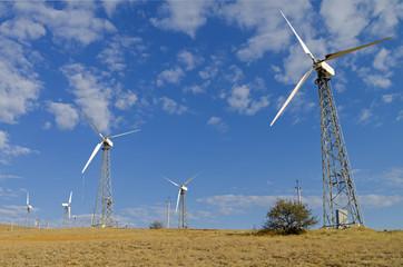 Wind power generators against the blue sky.