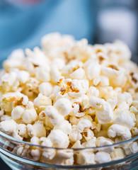 Glass bowl full of popcorn
