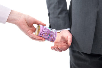 Businessman in a suit takes a bribe