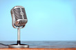 Vintage microphone on the table with cyanic background - 82267105