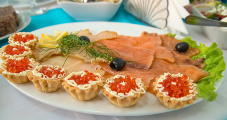 sliced fish and baked basket with red caviar
