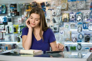 Woman Computer Shop Owner Examining Bills And Taxes