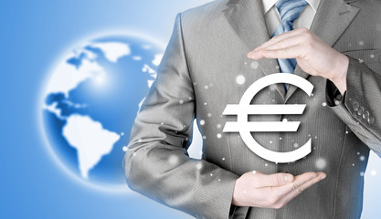 businessman protecting euro symbol