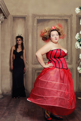 Two queens in carnaval dress. Black and red.