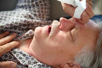 Senior man has terrible cold or flu