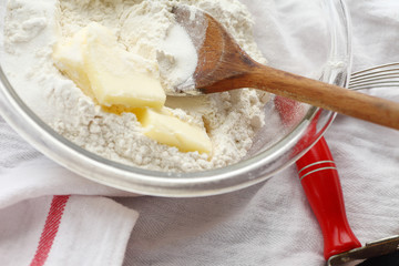 Mixing butter with flour in bowl