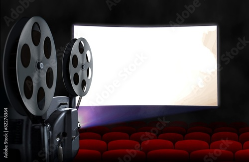 Leinwanddruck Bild Blank cinema screen with empty seats and projector