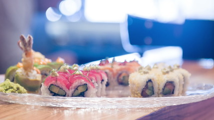 Selective focus on different delicious rolls lying in big plate