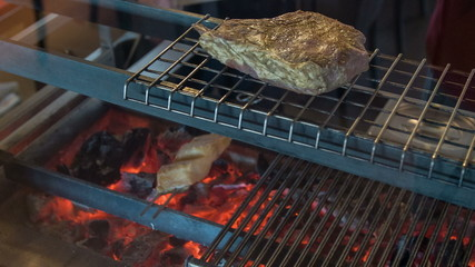 Horizontal dolly shot of appetizing T-bone steak